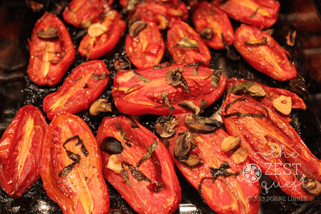 Roasted-Tomatoes-after-roasting-in-glass-dish-with-rosemary-basil-garlic-mushrooms-2-The-Zest-Quest