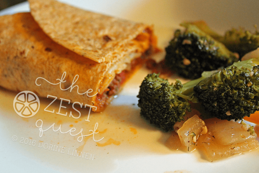Sloppy-Jo-on-a-sun-dried-tomato-basil-wrap-with-steamed-broccoli-and-onions-2-The-Zest-Quest